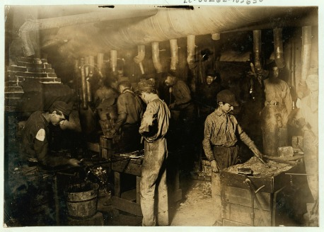 Boys working in a foundry.